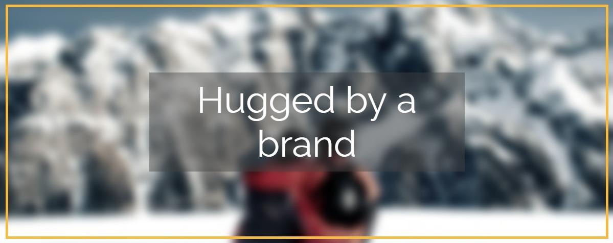 hugged by a brand